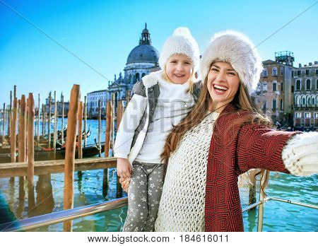 Mother And Daughter Travellers In Venice Taking Selfie