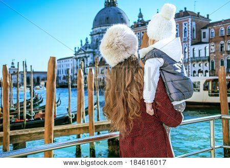 Mother And Daughter Travellers In Venice Having Excursion
