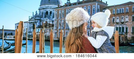 Mother And Daughter Tourists In Venice, Italy Embracing