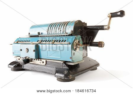 Old blue calculating machine on a white background.