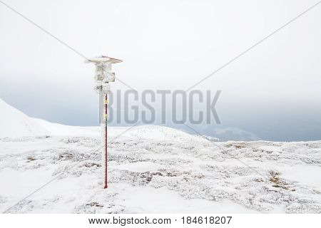 Snowy and icy pointer in mount Goverla.