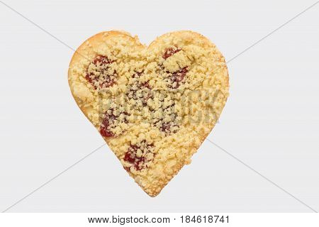 Streusel or crumble heart with jam on wood