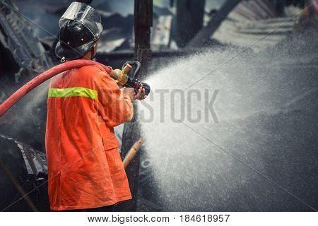 firefighters spraying water in fire fighting operation firefighter job in firefighter workplace