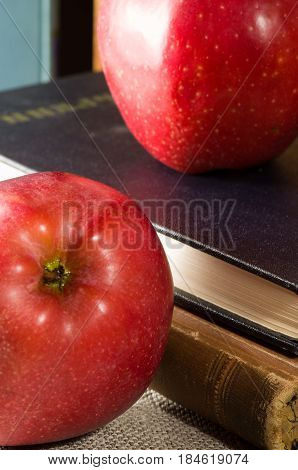 Fragment Of Old Books With Hardcover And Close-up Red Apples
