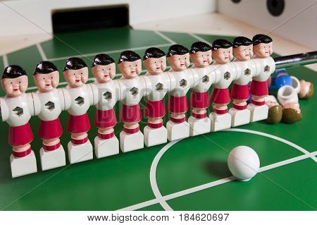toy football players stand on the football field several figures have fallen lie. Concept of excess unnecessary people