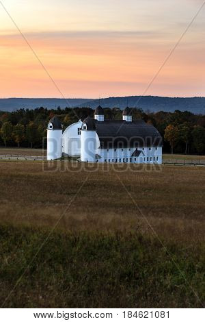 The sun rises over the D.H. Day Barn at Sleeping Bear Dunes National Lakeshore. poster