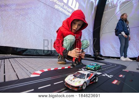 Moscow, Russia - 12 June 2016: world championship WTCC at the Moscow Raceway. A boy playing RC car model