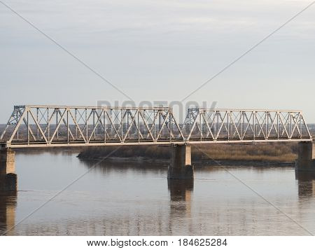 Railway bridge through the big river in Russia