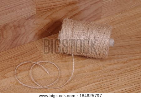 The Spool of twine on wooden table.