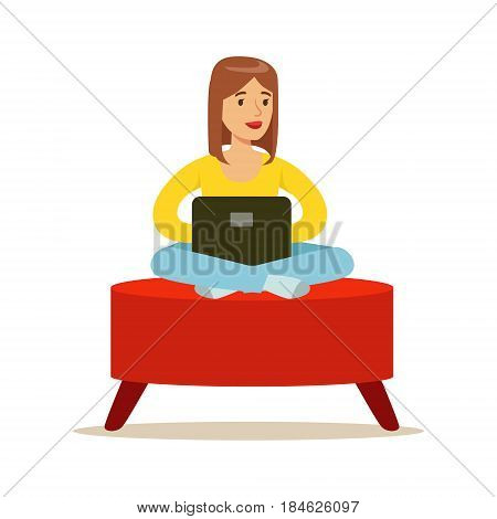 Happy young woman sitting in a red pouf and using laptop, colorful character vector Illustration isolated on a white background