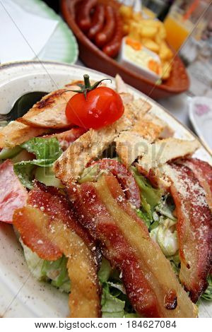 Serbian meat food with tomato in a dish