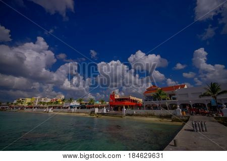 Beautiful vacation resort of Cozumel with some natural buildings, gorgeous blue ocean and sky.