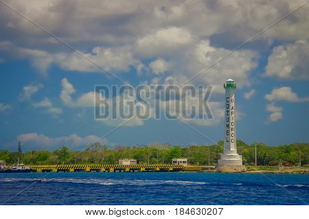 COZUMEL, MEXICO - MARCH 23, 2017: Beautiful atraction of Cozumel with somenatural buildings and yatchs, gorgeous blue ocean and sky.