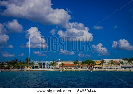 Beautiful port of Cozumel with some boats and buildings behind.