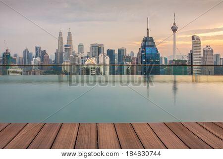 Kuala Lumpur, Malaysia - September 25, 2016: Kuala Lumpur city view with famous Petronas towers and Menara KL tower, Malaysia