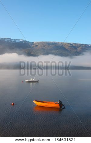 Norway Lake With Fog And Mountains
