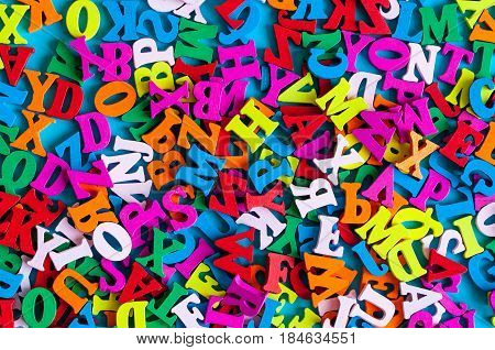 English letters on blue background composed from colorful abc alphabet leter. Learning english or other language concept