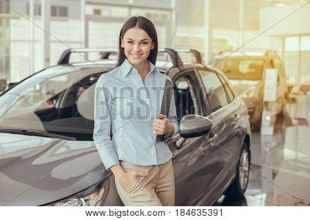 Young woman assistant in a car rental service occupation