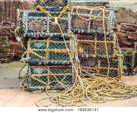 Fishing lobster baskets and crabs layered on top of each other fishing industry fishing lines seaside town