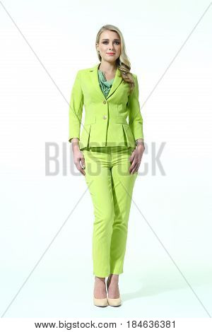business  blond woman in green summer pant suit  full body length high heeled shoes back shot isolated on white