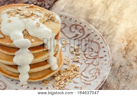 Stack Of Hot Pancakes With Oatmeal And Yogurt.