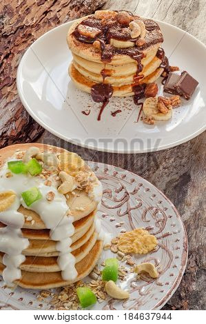 Dual Stack Of Hot Pancakes With Chocolate And Yogurt.