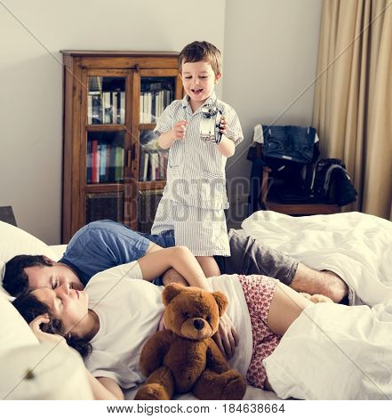 Boy Awakening Dad and Mom in the Bedroom