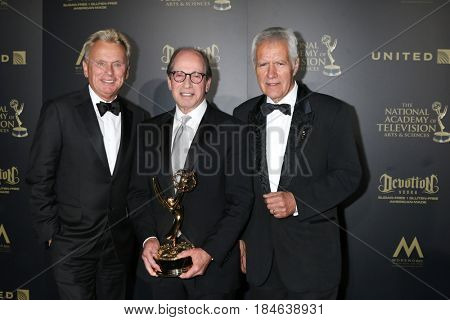 LOS ANGELES - APR 29:  Pat Sajak, Harry Friedman, Alex Trebek at the 2017 Creative Daytime Emmy Awards at the Pasadena Civic Auditorium on April 29, 2017 in Pasadena, CA