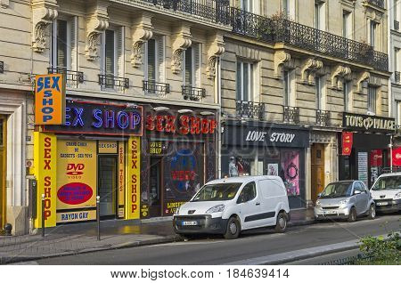 PARIS FRANCE - MARCH 31 2017: A variety of sex shops on Boulevard de Clichy. Quartier Pigal (red light district) in Paris France. Morning there are no clients and so everything is closed.