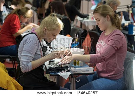 Moscow, Russia - March 3, 2017: Competition of manicure at the Esthetic Life Exhibition