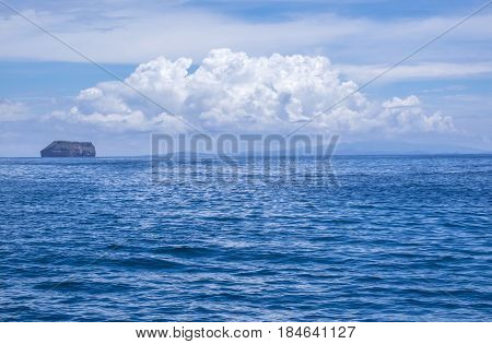 Ocean and Blue Sky with Dramatic Clouds in the Galapagos Islands Ecuador