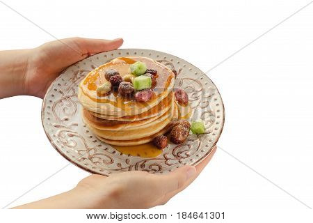 Stack Of Hot Pancakes In Woman Hands. Isolated
