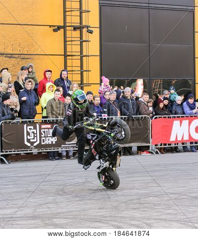 St. Petersburg Russia - 15 April, Freestyle on motobikes,15 April, 2017. International Motor Show IMIS-2017 in Expoforurum. Sports motorcycle show of bikers on the open area.