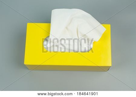 Tissues box on gray background. yellow Tissues box