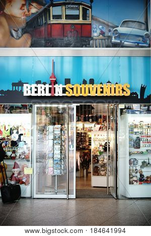 BERLIN, GERMANY - MAY 01: A nostalgically painted souvenir shop with goods in the shop windows in the Berlin railway station on May 01 2017 in Berlin.