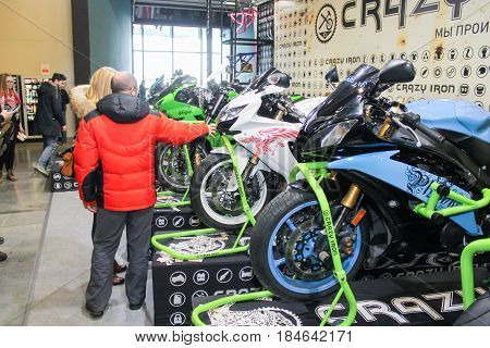 St. Petersburg Russia - 15 April, Visitors to motorbike racing,15 April, 2017. International Motor Show IMIS-2017 in Expoforurum. Visitors and participants of the annual moto-salon in St. Petersburg