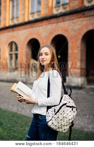 Outdoor Portrait Of Pretty Student Girl In The Street After Class.