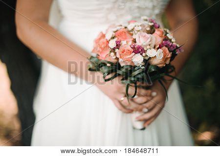 wedding bouquet in bride's hands tender newlyweds