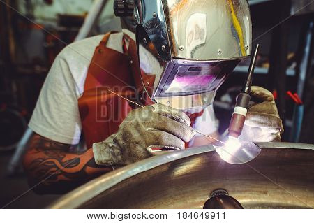 The Man In The Mask Brews Beautiful Welds With Argon-arc Welding