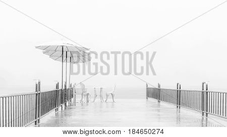 Abstract background Hi key black and white : The relax siting briged in the fog after rain