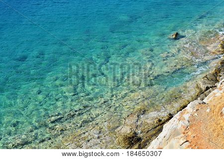 turquoise tranquil clear water texture rocky bottom of the sea vocation concept