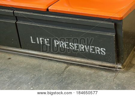 Life Preservers stored under the seats inside the Staten Island Ferry.