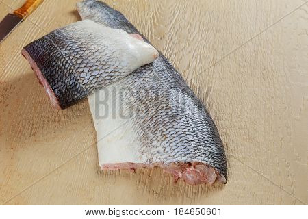 Top View Of Cleaning And Filleting A Fresh Blyufish