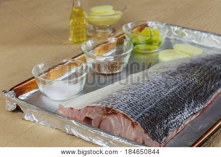 Marinated Fish With Lemon And Onion Dish In The Oven