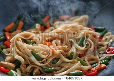 Delicious rice noodle stewing with vegetables and chicken