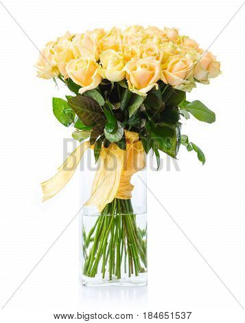 Bouquet of yellow roses in glass vase over white background