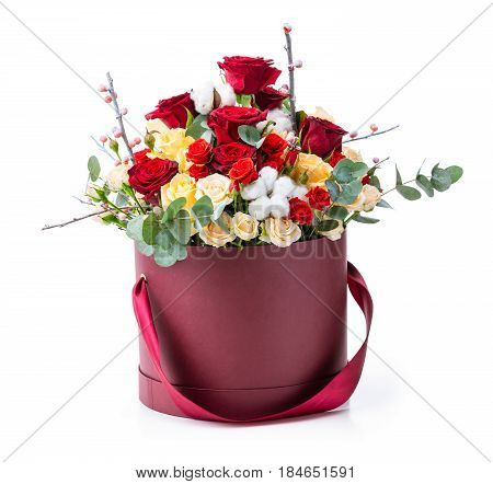 Bouquet of colorful roses in decorative paper box over white background
