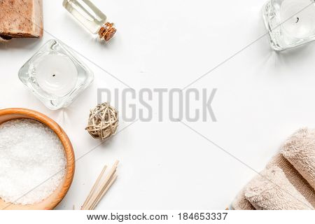spa set with salt and organic soap on white table background top view mockup