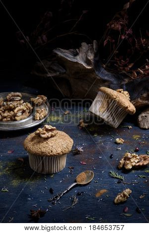 Small Walnut Pastry With Nuts And Cinnamon On Dark Table.