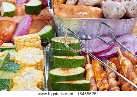 Marinated meat and vegetables prepared for grilling